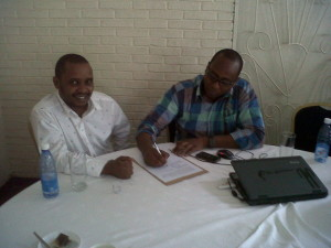 Allan (L) and Michael (R)  the technical innovators behind M-KURA put pen to paper.